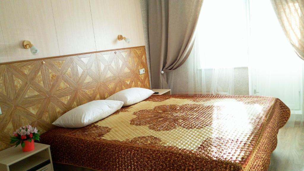 Кровать или кровати в номере Home in Yasenevo