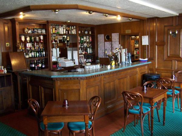 The lounge or bar area at Lochgair Hotel