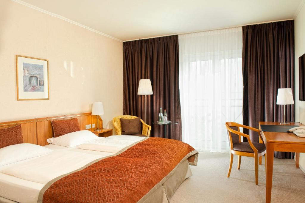 Ein Bett oder Betten in einem Zimmer der Unterkunft Wyndham Hannover Atrium