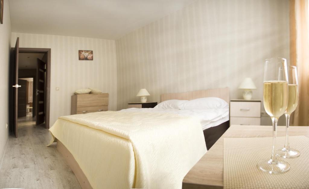 Кровать или кровати в номере Home Like on Kutuzovskaya 23