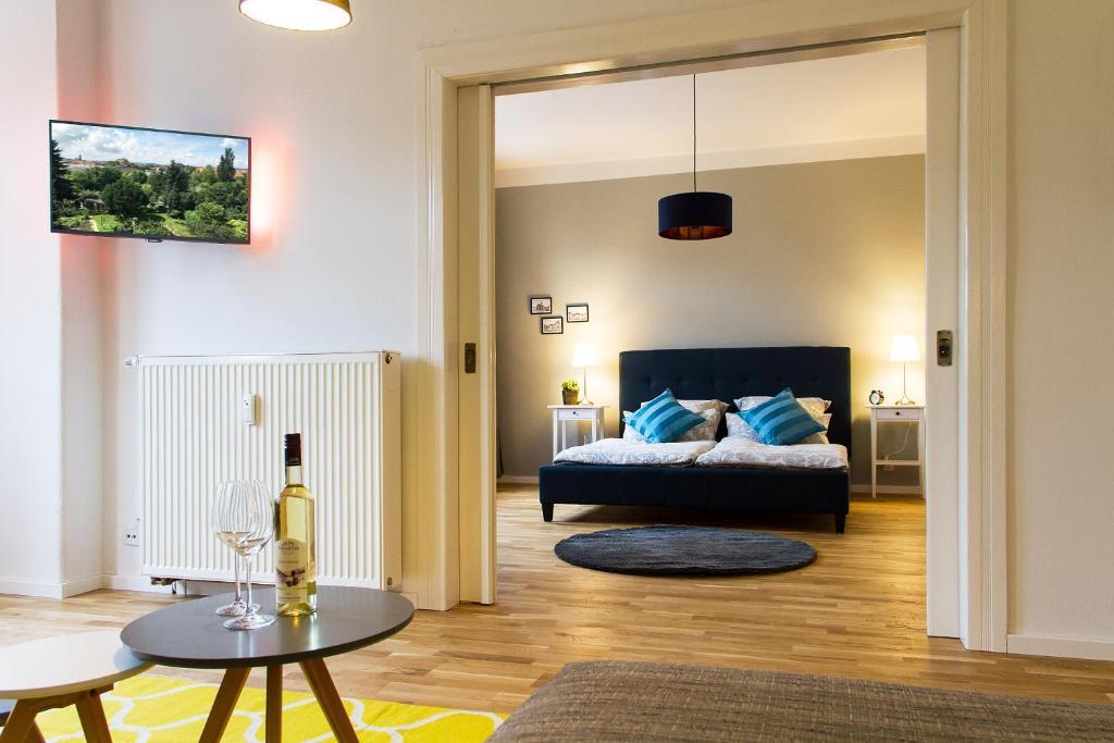 Ein Bett oder Betten in einem Zimmer der Unterkunft Stadtbleibe Naumburg