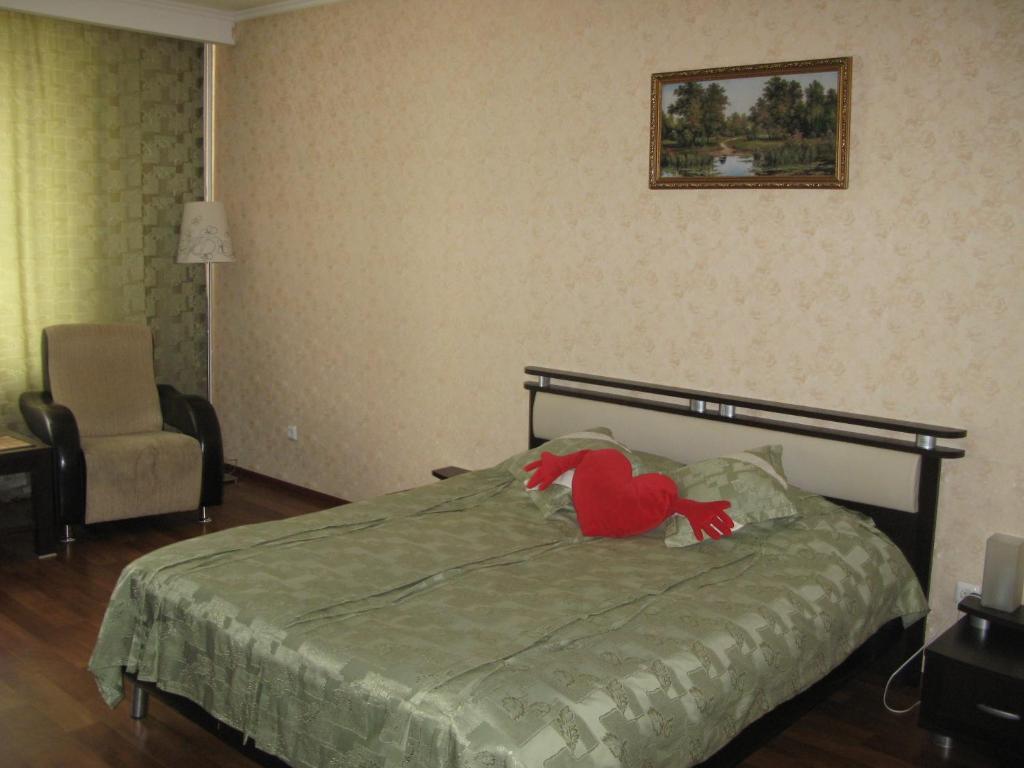 Кровать или кровати в номере Apartment in Center on Lomonosova55