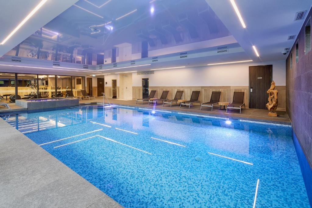 The swimming pool at or near Van der Valk Hotel Princeville Breda