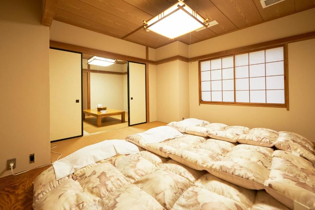 A bed or beds in a room at Select inn Iwaki Ekimae