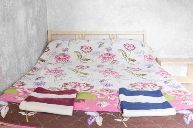 A bed or beds in a room at Apartments at Proletarskaya 19