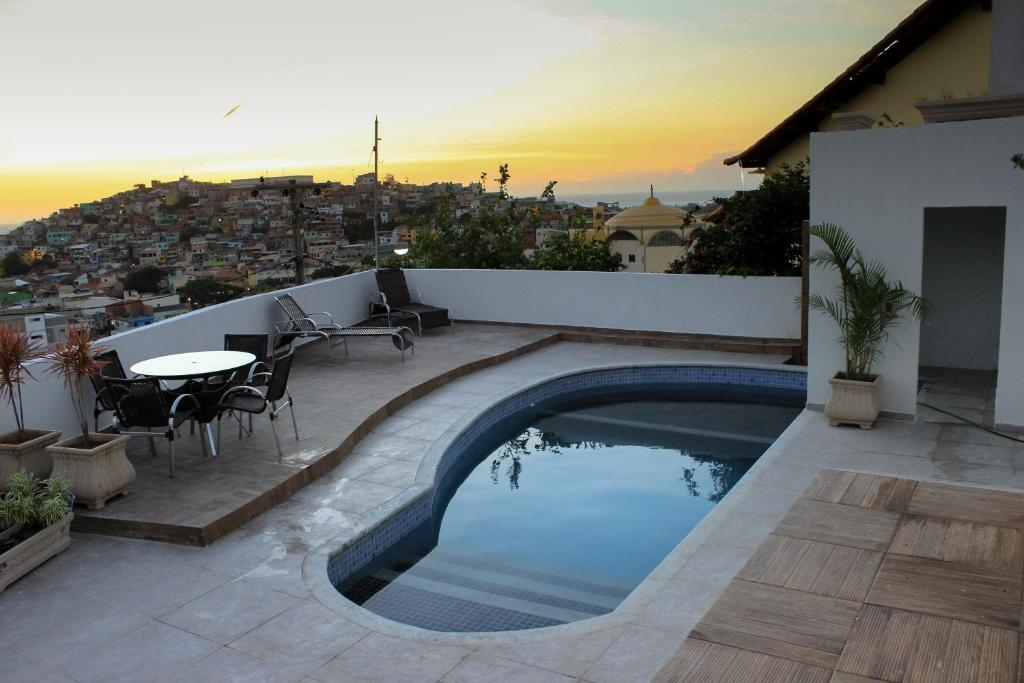 The swimming pool at or close to Pousada Xerxes