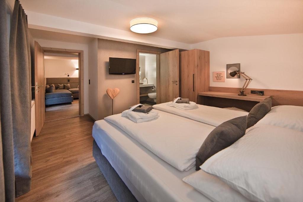 Ein Bett oder Betten in einem Zimmer der Unterkunft Villa Michaela