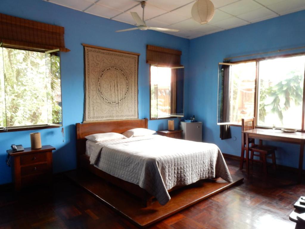 A bed or beds in a room at La Casa Fitzcarraldo