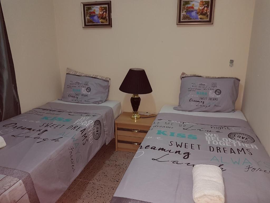 Cama ou camas em um quarto em Sewdien's Apartment Curacao