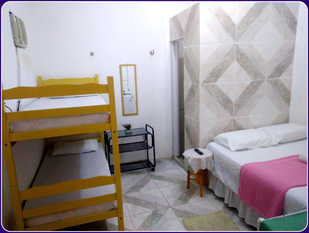 A bunk bed or bunk beds in a room at Hospedaria Praia e Sol