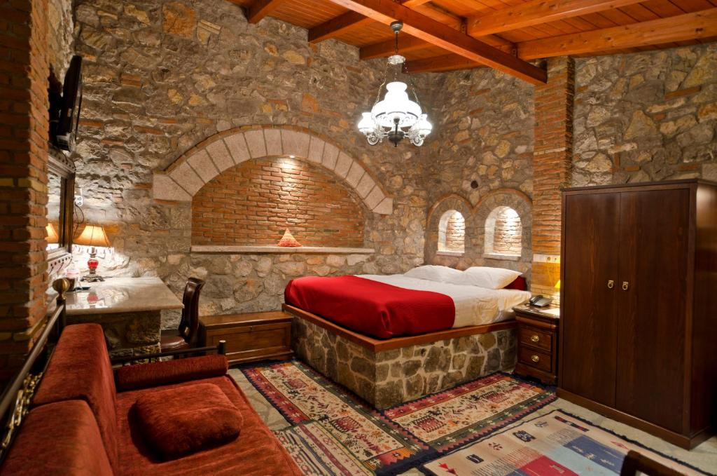 Ένα ή περισσότερα κρεβάτια σε δωμάτιο στο Μαριάννα