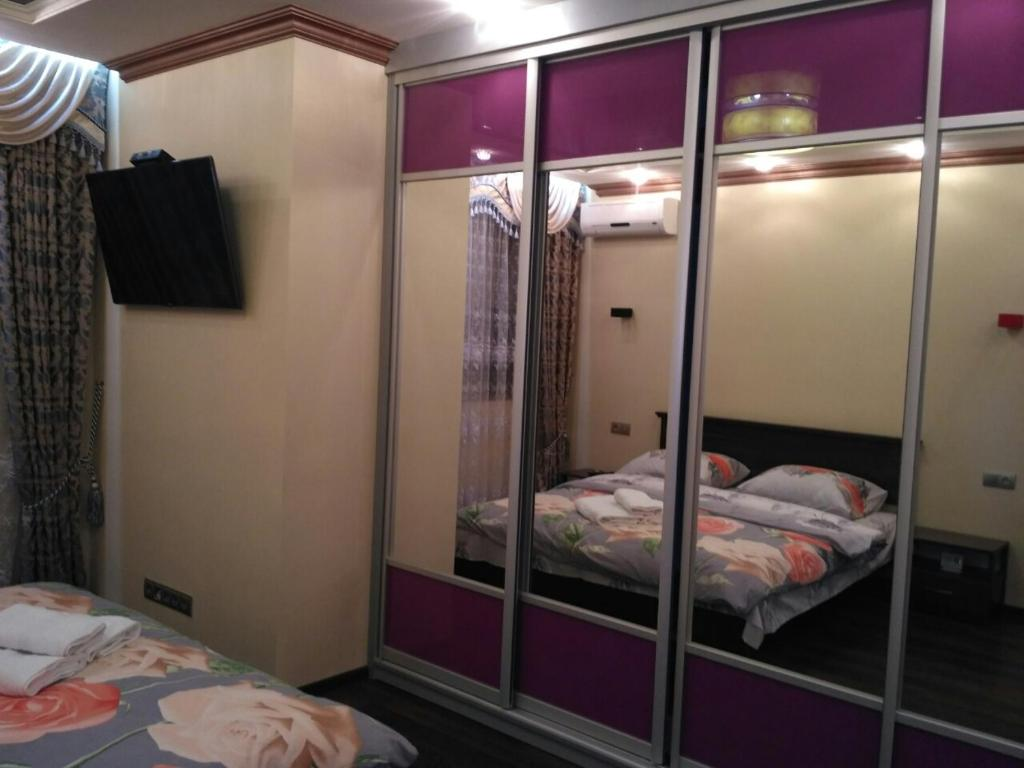 A bed or beds in a room at GIL Apartment квартира возле ТЦ Дастор