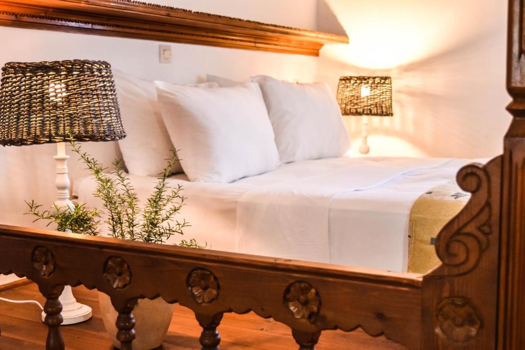 Letto o letti in una camera di Astron Hotel