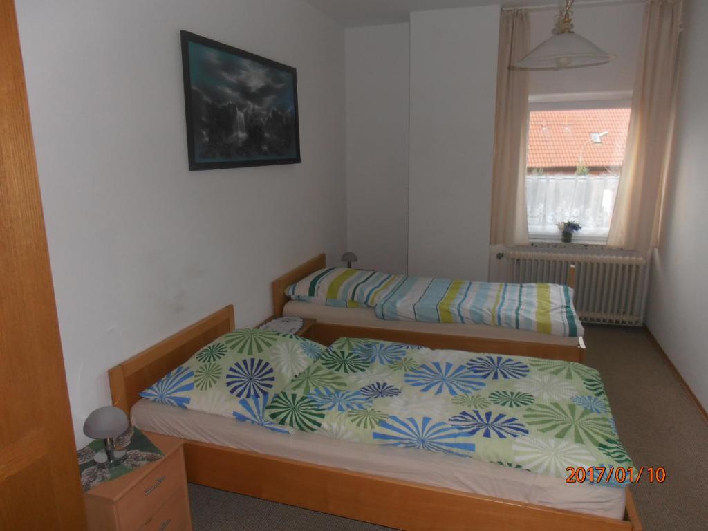 Ein Bett oder Betten in einem Zimmer der Unterkunft Landhaus Berkenthin