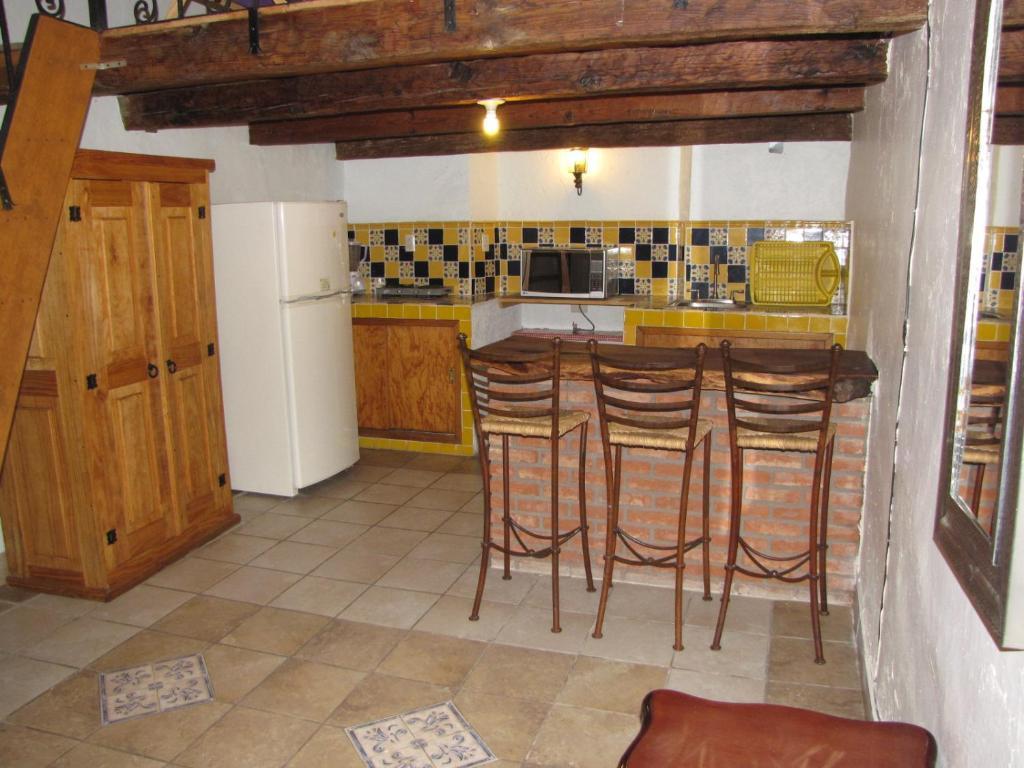 Una cocina o zona de cocina en La Capilla