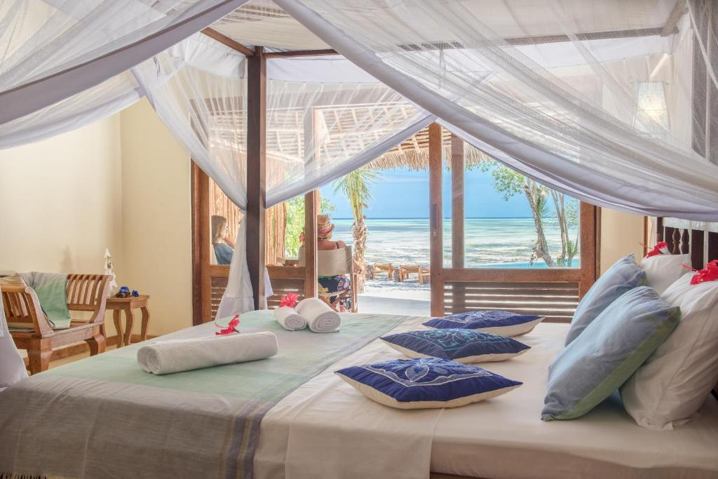 A bed or beds in a room at Marafiki Bungalows
