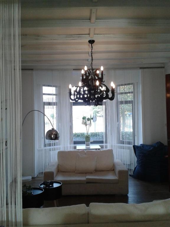 Coin salon dans l'établissement Villa Emma