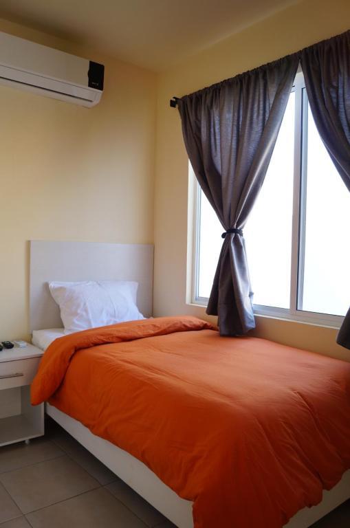 Cama o camas de una habitación en MV Suites