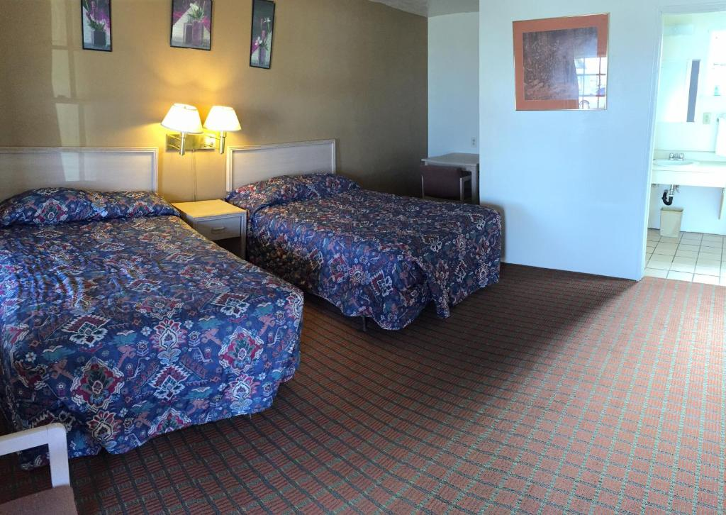 A bed or beds in a room at Budget Inn Safford