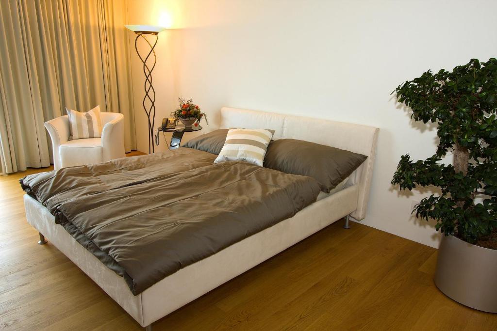 Ein Bett oder Betten in einem Zimmer der Unterkunft Senevita Residenz & Apartments Muri bei Bern