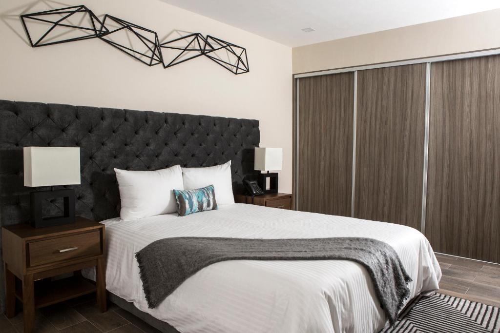 Cama o camas de una habitación en Suites Rio Elba