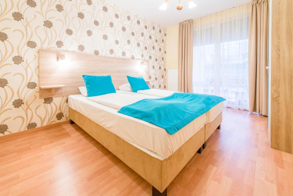 Cama o camas de una habitación en Nova Aparthotel