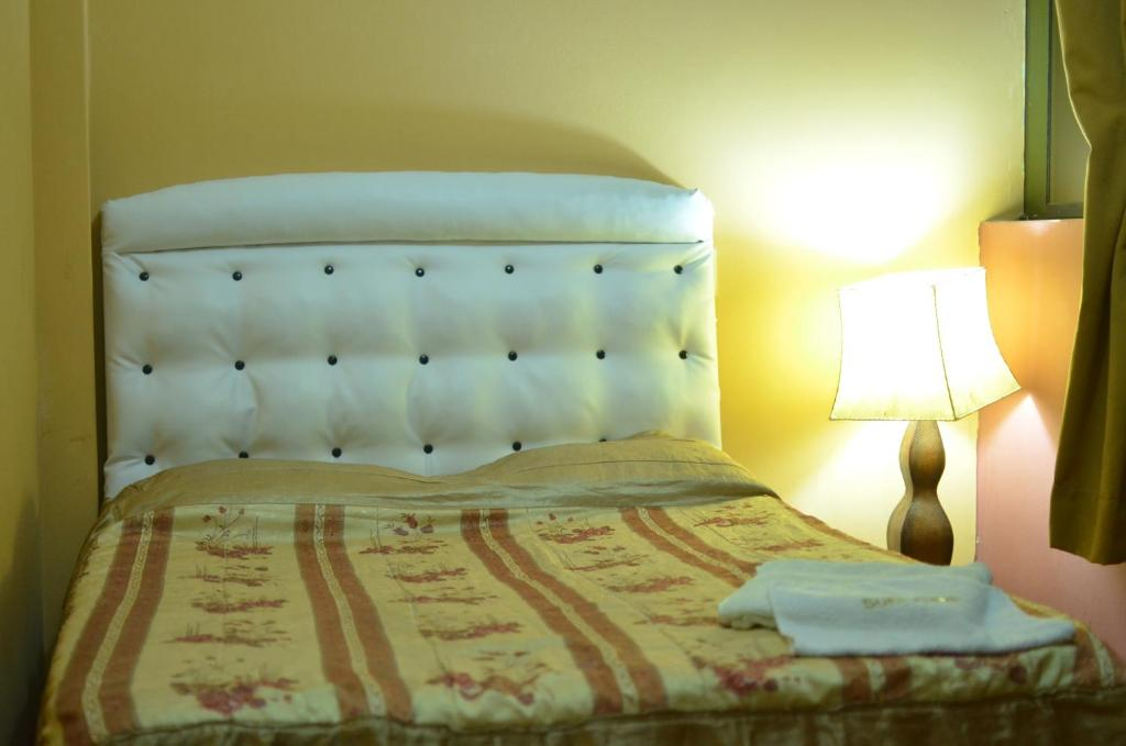 A bed or beds in a room at Mama Chelita