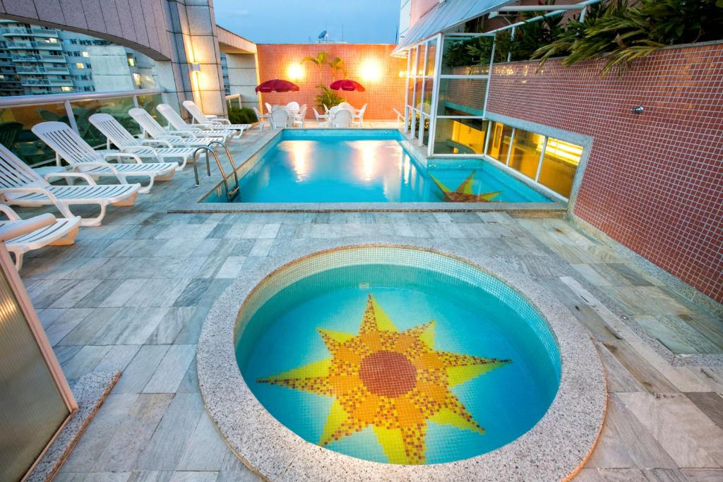 The swimming pool at or near Scorial Rio Hotel