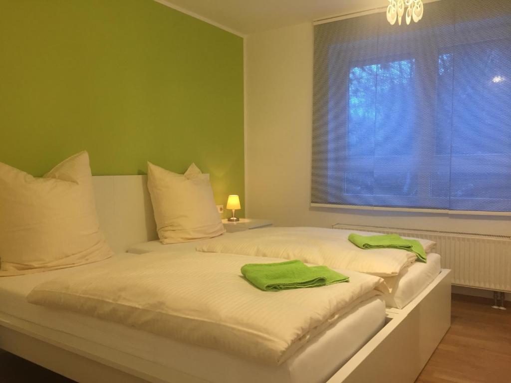 Ein Bett oder Betten in einem Zimmer der Unterkunft Apartment Ardi II
