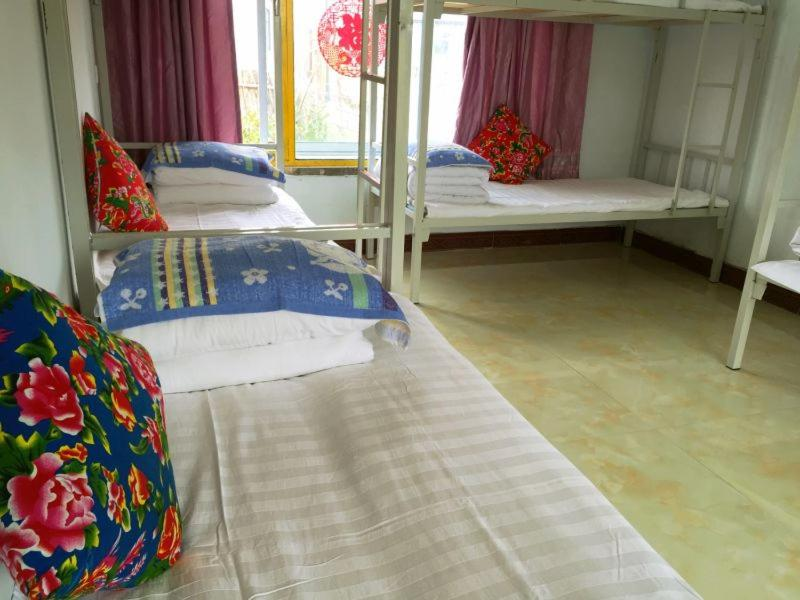 A bed or beds in a room at Jilin Wu Song Dao Jia Xin Hostel