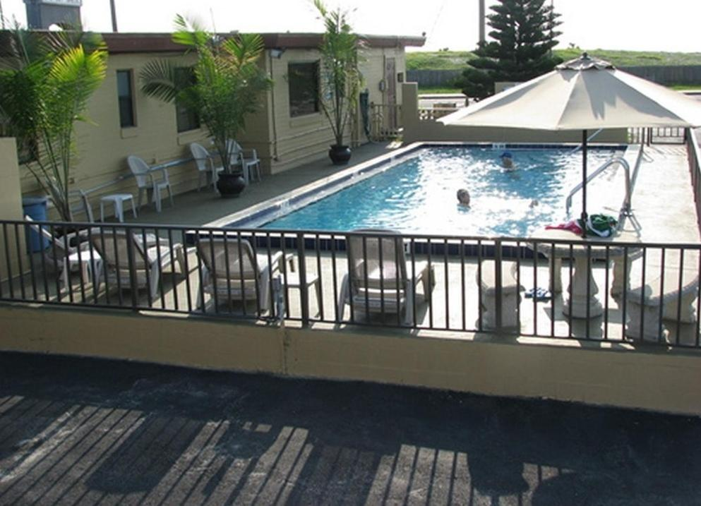 The swimming pool at or near Atlantic Economy Inn