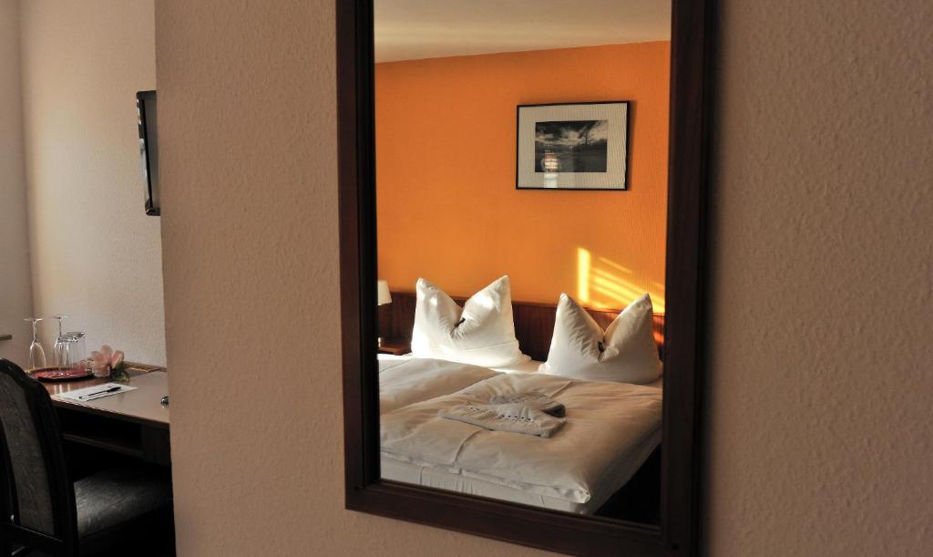 Ein Bett oder Betten in einem Zimmer der Unterkunft Pension am Theater