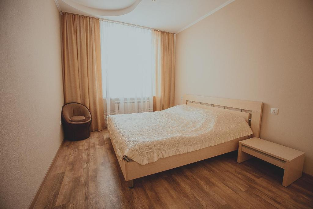 A bed or beds in a room at Hotel Novaya