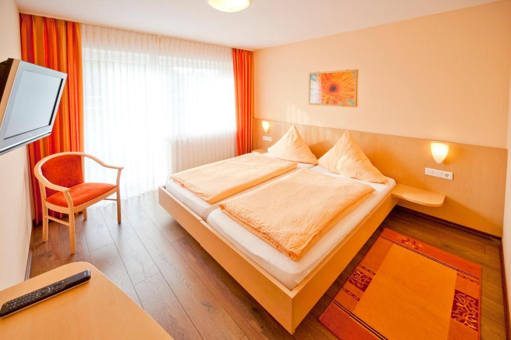 Ein Bett oder Betten in einem Zimmer der Unterkunft Landgasthof Feihl