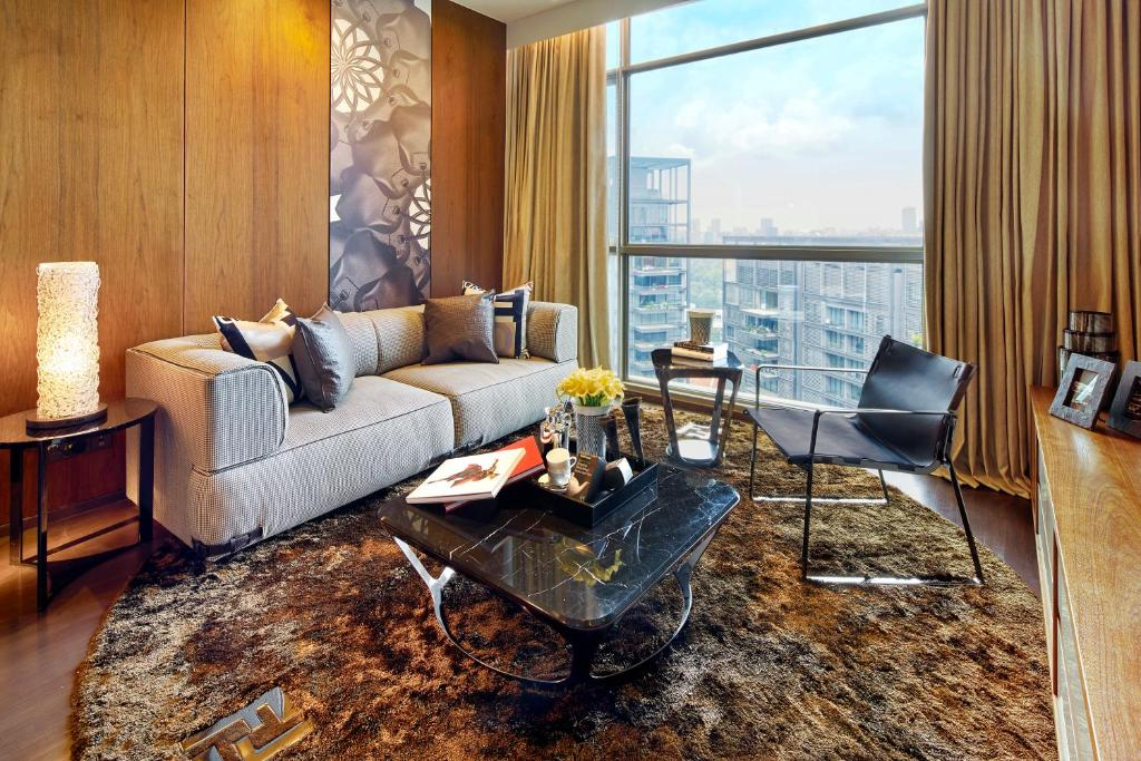 A seating area at Ascott Orchard Singapore (SG Clean, Staycation Approved)