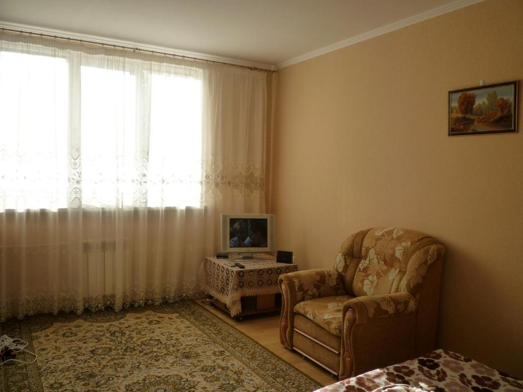 A seating area at Apartment on Lermontova