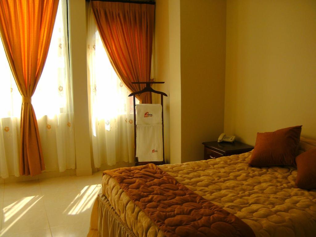 Cama o camas de una habitación en Hostal Fevilamir