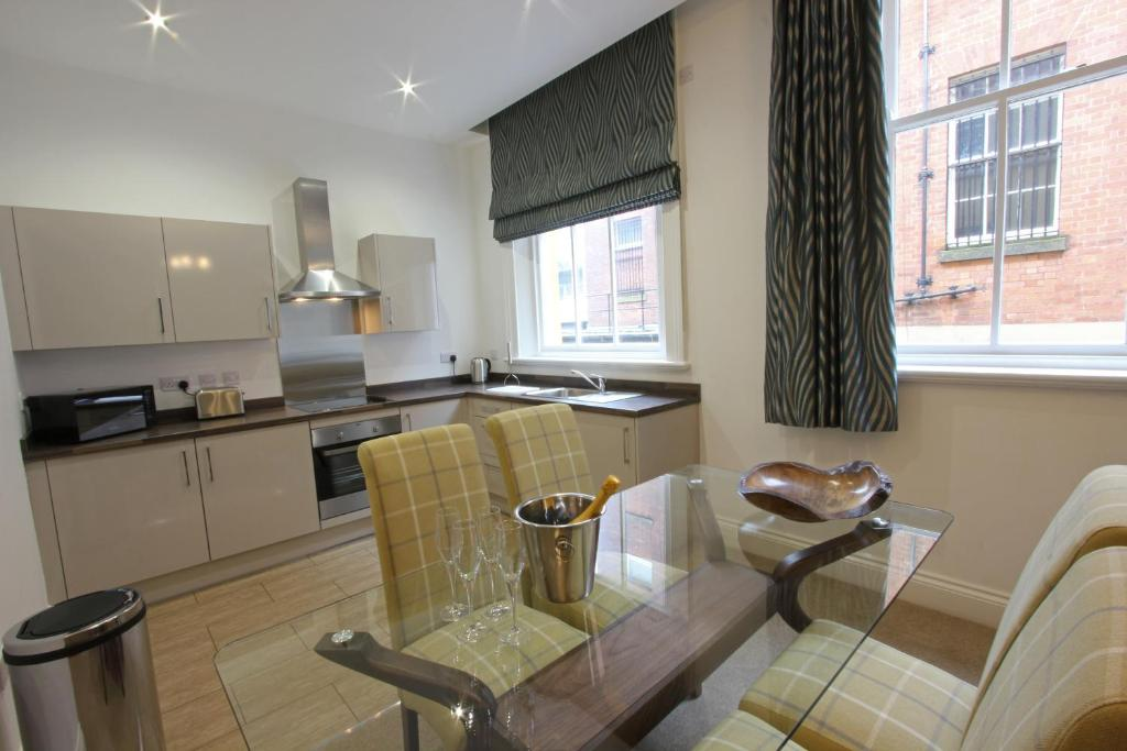 A kitchen or kitchenette at The Castle Collection - 25 Castle Street