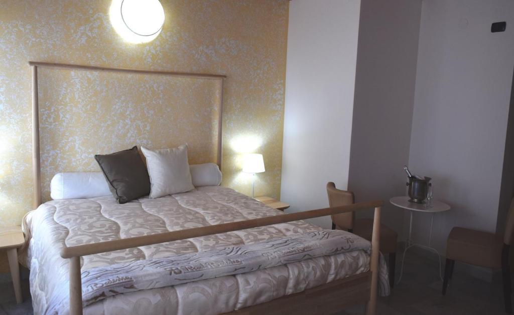 Кровать или кровати в номере Hotel Quadrifoglio
