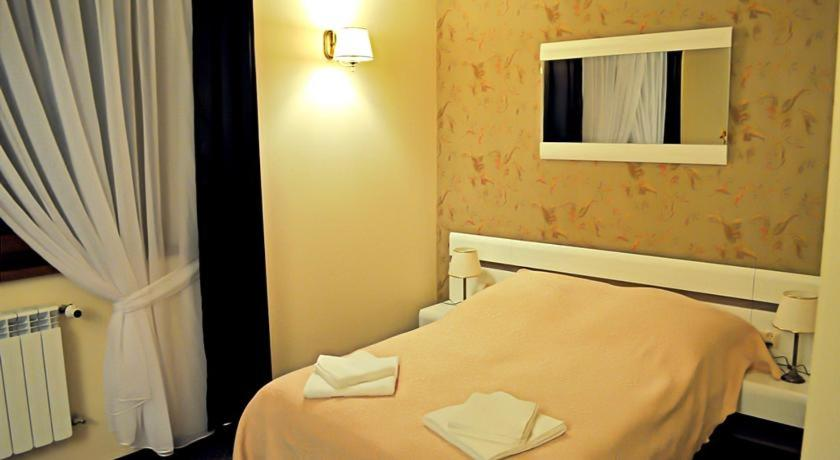 A bed or beds in a room at Hotel u Liska