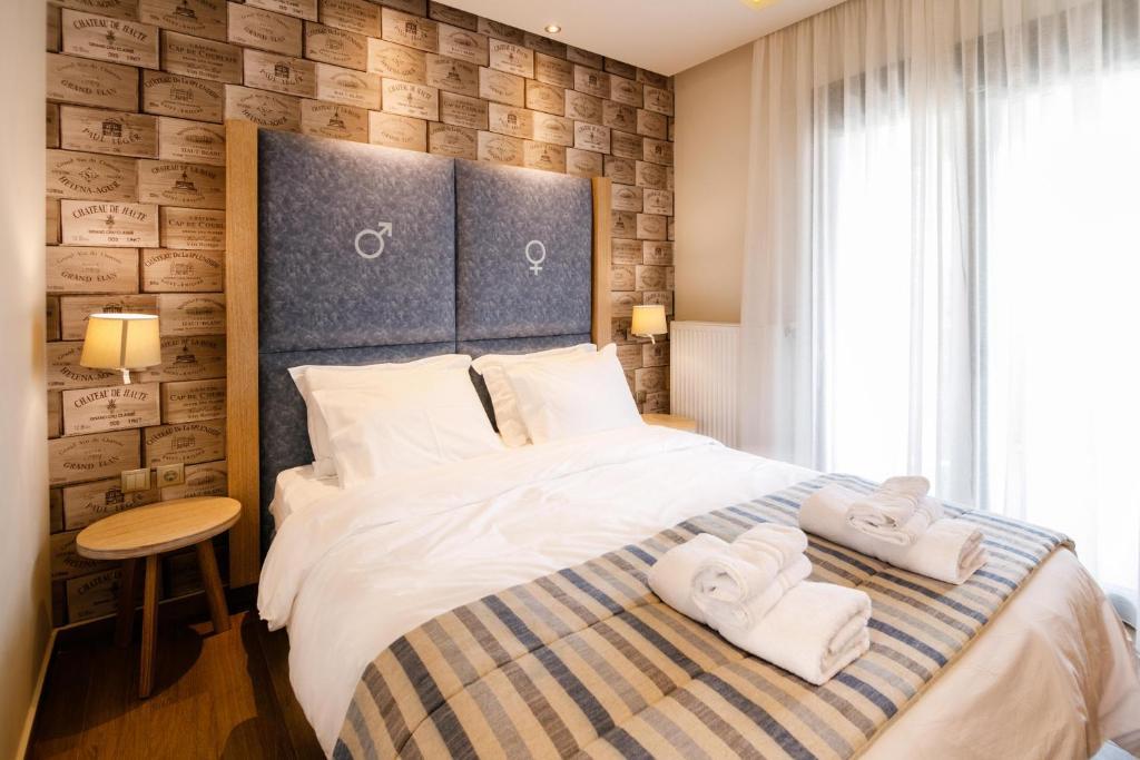 Кровать или кровати в номере Green Sea Apartments