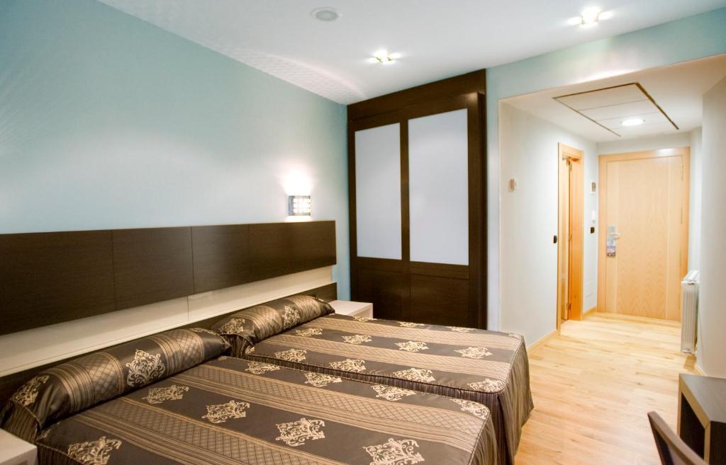 A bed or beds in a room at Hospedaje La Tortuga