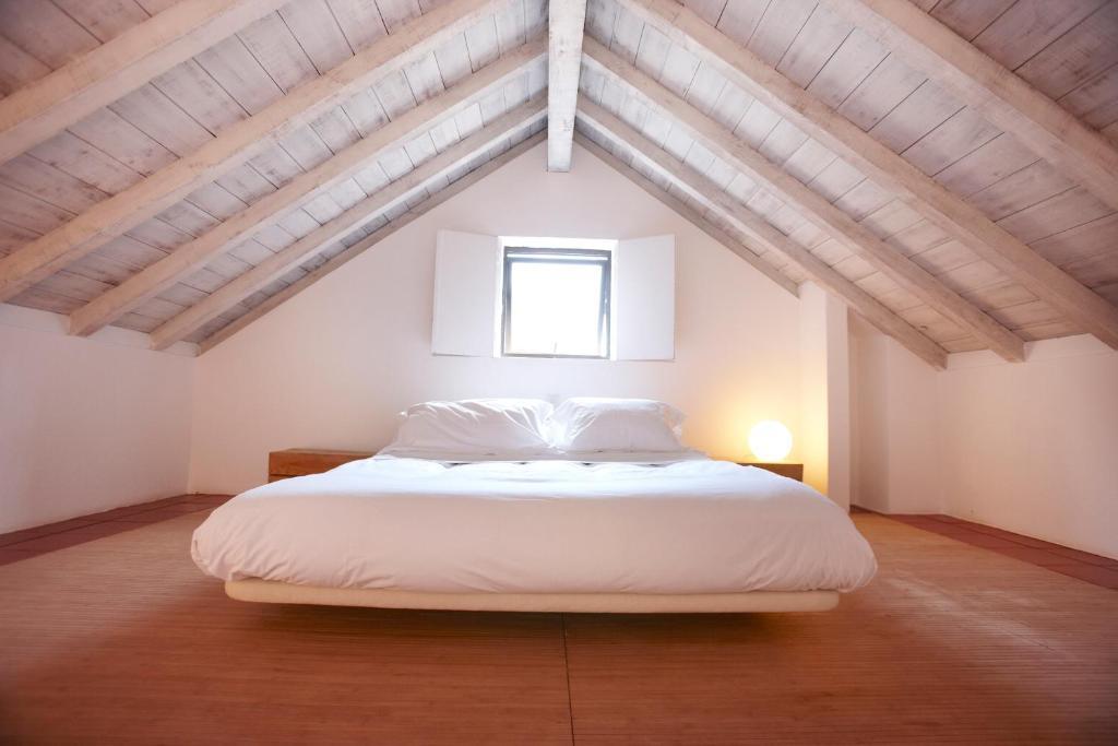 Een bed of bedden in een kamer bij Quinta Do Miguel