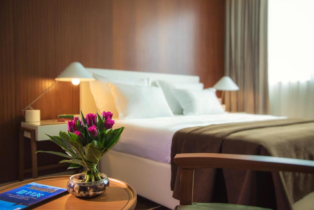 A bed or beds in a room at Prima Millennium