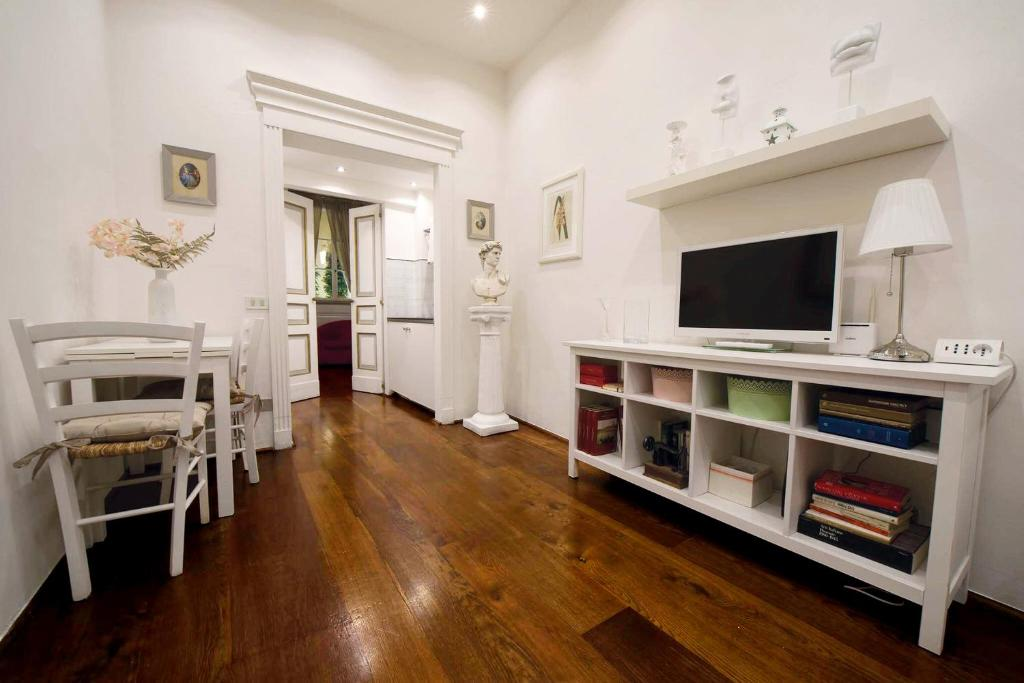 A television and/or entertainment center at Santo Spirito Suite