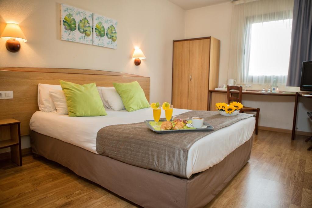 Cama o camas de una habitación en Campanile Hotel Elche