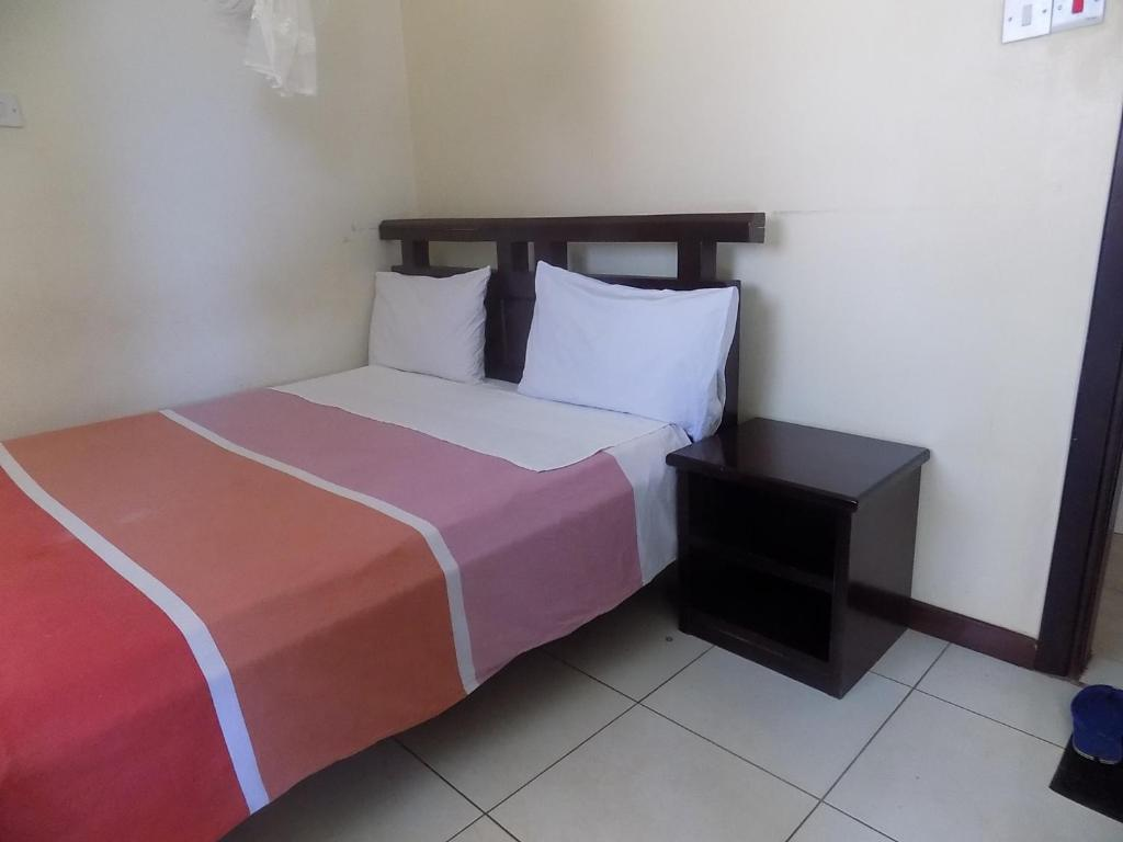 A bed or beds in a room at Etana Motel