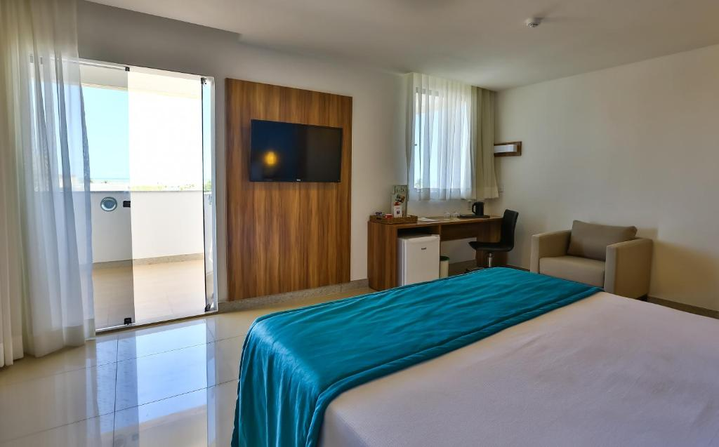 A bed or beds in a room at Arcus Hotel Aracaju - Ant. Comfort
