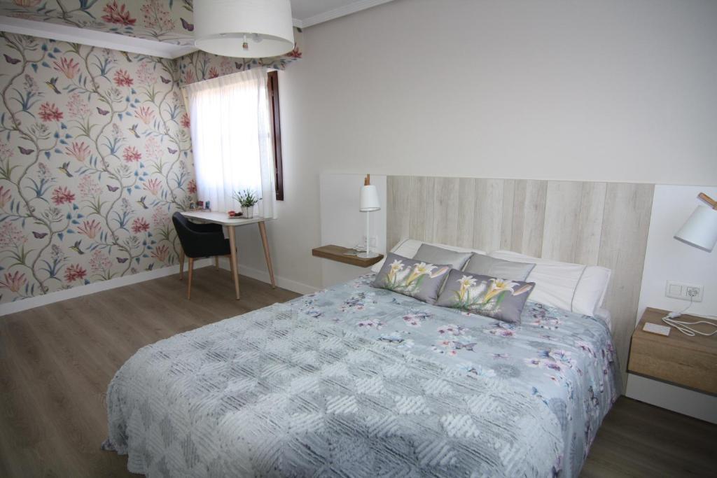 Cama o camas de una habitación en Casa Rural Artola