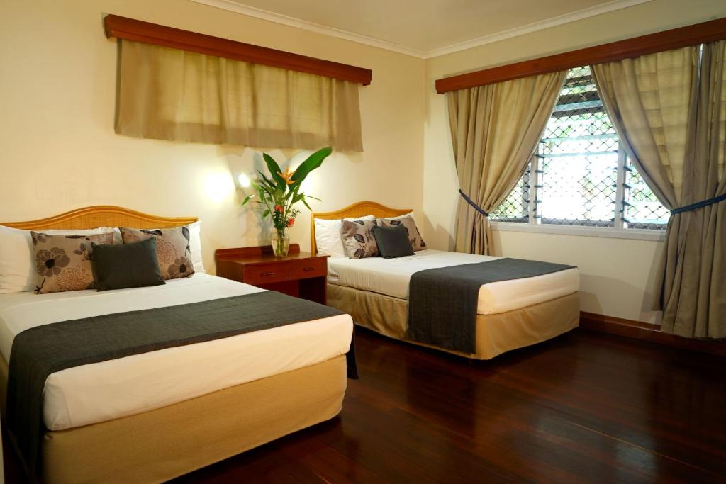 A bed or beds in a room at Liamo Reef Resort